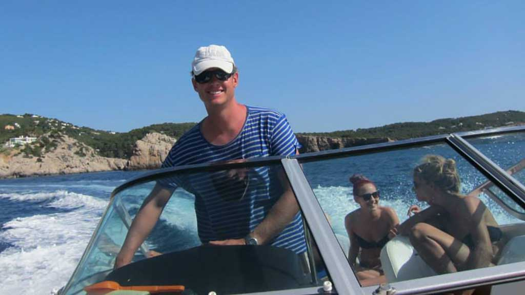 Neil at the helm of a speedboat